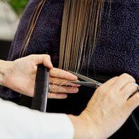 Woman haircut closeup